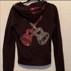 Pink sweatshirt. Bedazzled with guitars